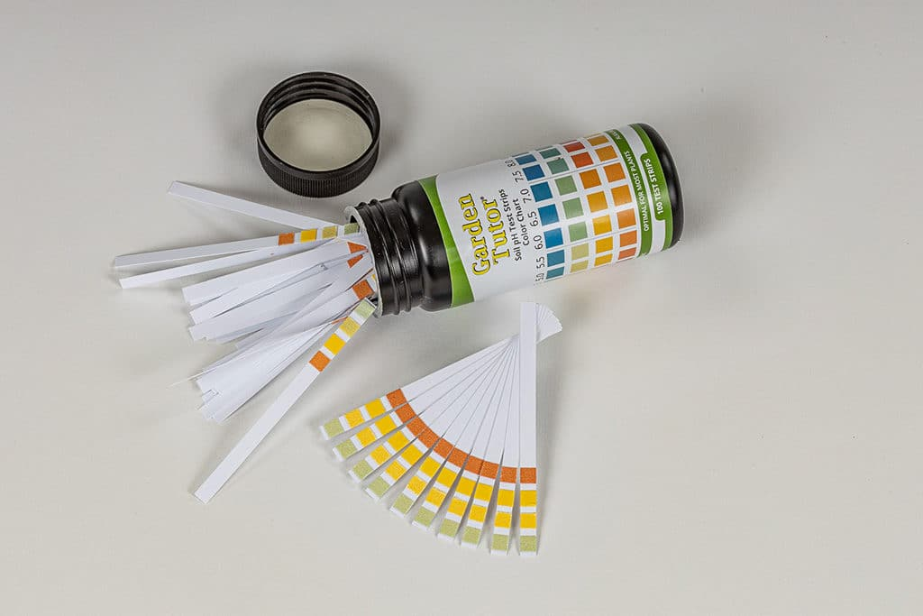 A picture of the Garden Tutor soil pH test strips and the bottle that they are packaged in